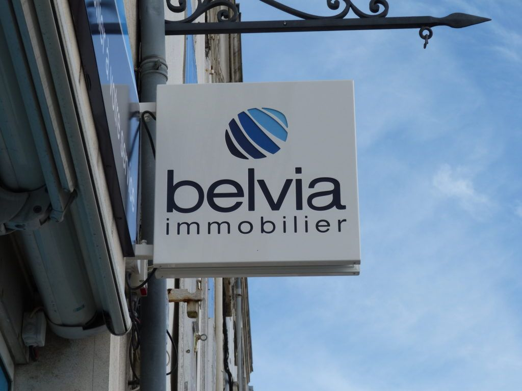 Caisson drapeau - Belvia Immobilier